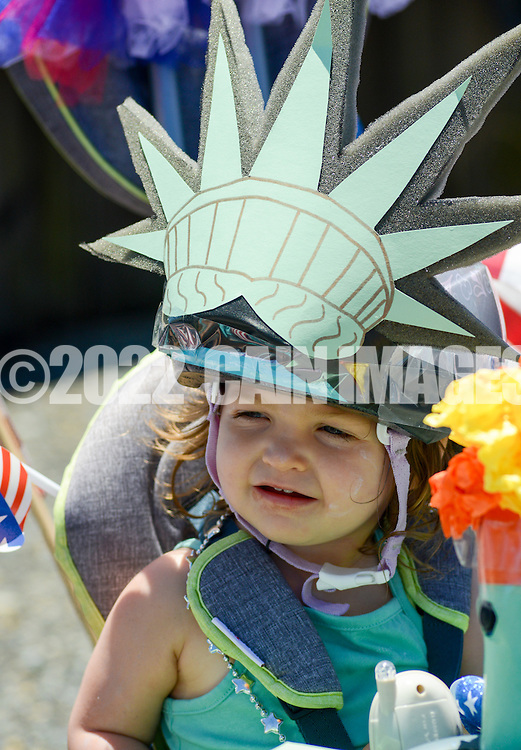 A young girl wears a statue of liberty costume during the Independence Parade Saturday July 2, 2016 on Beach Avenue in Cape May, New Jersey. Photo by William Thomas Cain/Cain Images