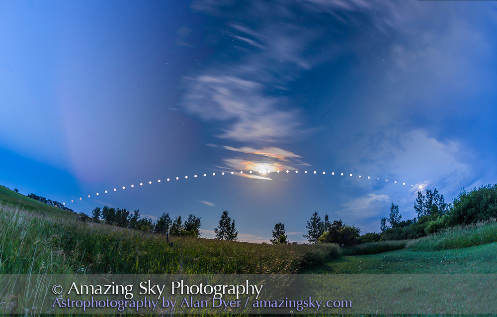 A multiple exposure composite showing the arc of the Full Moon of July 9/10, 2017 low across the southern sky on a summer night from dusk to dawn. This illustrates the low arc of the Moon across the sky in northern summer, from southeast at left to southwest at right. <br /> <br /> The sky is a blend of three long exposures:<br /> <br /> &bull;&nbsp;for the dusk 10 p.m. sky (left) with crepuscular rays in the clear twilight, <br /> &bull;&nbsp;the 2 a.m. middle-of-the-night sky with the Moon nearly due south (middle) with stars and iridescent colours around the Moon in light cloud, <br /> &bull;&nbsp;and the dawn 5 a.m. sky (right) with increasing clouds hiding the Moon. <br /> <br /> The Moon disks come from a series of short 1/15-second exposures, to record just the disks of the bright Moon. I took shots every minute but selected images taken at 10-minute intervals here for the composite.<br /> <br /> Taken from home on a warm and dry summer night with no dew! Stacked and blended in Photoshop, with Lighten blend modes and gradient masks. Shot with a 15mm full-frame fish-eye lens and Canon 6D.