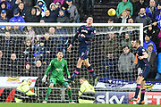 Portsmouth striker Oliver Hawkins (9) heads clear off his line during the EFL Sky Bet League 1 match between Milton Keynes Dons and Portsmouth at stadium:mk, Milton Keynes, England on 10 February 2018. Picture by Dennis Goodwin.