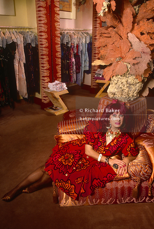 A formal portrait of English fashion designer, Zandra Rhodes in the summer of 1989 at her Grafton Street boutique, central London England. Dame Zandra Lindsey Rhodes, DBE RDI (b1940 studied first at Medway and then at the Royal College of Art in London. Her major area of study was printed textile design.