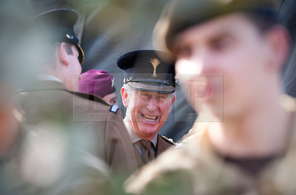 © Licensed to London News Pictures. 01/03/2012. Hounslow, UK.  HRH  Prince Charles  shares a joke with members of The Prince of Wales Guards devision of The Welsh Guards after presenting leeks to 1st Battalion The Welsh Guards at Cavalry Barracks,  Hounslow, London on St David's Day, March 1st, 2012.  Two-thirds of the Battalion's 600 soldiers are due to be deployed to Afghanistan in the next two weeks. Photo credit : Ben Cawthra/LNP