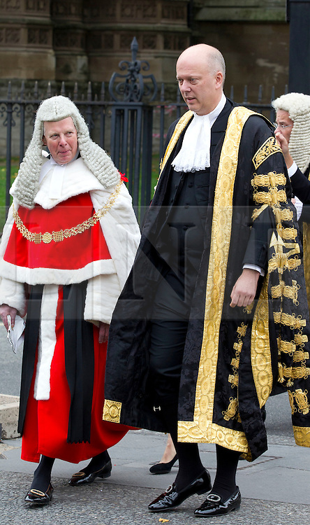 © Licensed to London News Pictures. 01/10/2013. London, UK. The British Lord Chancellor and Secretary of State for Justice Chris Grayling is seen wearing his ceremonial robes as he walks with judges to the Houses of Parliament after a service to mark the start of the legal year held at Westminster Abbey in London today (01/10/2013). Photo credit: Matt Cetti-Roberts/LNP