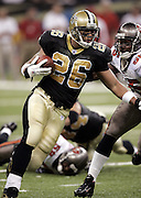 NEW ORLEANS - OCTOBER 10:  Running back Deuce McAllister #26 of the New Orleans Saints runs the ball against the Tampa Bay Buccaneers at the Louisiana Superdome on October 10, 2004 in New Orleans, Louisiana. McAllister rushed for 102 yards on 21 carries but fumbled twice, losing one of them to the Bucs. The Bucs defeated the Saints 20-17. ©Paul Anthony Spinelli *** Local Caption *** Deuce McAllister