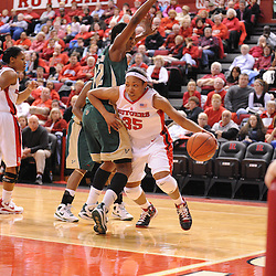 Jan 31, 2009; Piscataway, NJ, USA; Rutgers guard Brittany Ray (35) pushes her way past South Florida center Brittany Denson (32) during the second half of South Florida's 59-56 victory over Rutgers in NCAA women's college basketball at the Louis Brown Athletic Center