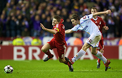 LIVERPOOL, ENGLAND - Wednesday, December 9, 2009: Liverpool's captain Steven Gerrard MBE is tackled by AFC Fiorentina's Riccardo Montolivo during the UEFA Champions League Group E match at Anfield. (Photo by David Rawcliffe/Propaganda)