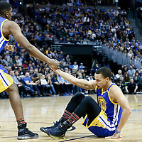 13 February 2017: Golden State Warriors forward Kevon Looney (5) helps Golden State Warriors guard Stephen Curry (30) to stand up during the Denver Nuggets 132-110 victory over the Golden State Warriors, at the Pepsi Center, Denver, Colorado, USA.