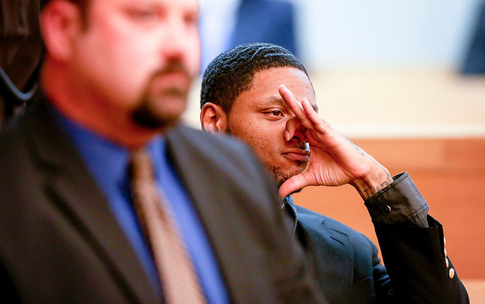 Kyle Green | The Roanoke Times<br /> 11/30/2012 Gene Anthony Brown makes a crips gang sign after the jury in his first-degree murder trial delivered a guilty verdict in Roanoke Circuit Court. A jury found Brown guilty of first-degree murder tonight in the death of Afton Apartments security guard Steve Orange. The jury deliberated a little more than nine hours before reaching the verdict. Brown was sentenced to 38 years in prison. He also was found guilty of use of a firearm in commission of a murder.