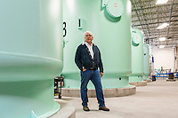Bill Stowe is the CEO and General Manager of the Des Moines Water Works. He was photographed next to the tanks that the Water Works uses to filter excessive nitrates from drinking water in Des Moines, Iowa, on April 13, 2015. Photo by Ryan Donnell.