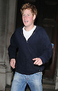 24.APRIL.2009 - LONDON<br /> <br /> A VERY CHEERFUL PRINCE HARRY LEAVING KITTS CLUB, KNIGHTSBRIDGE AT 4.00AM VIA THE BACK DOOR AND HE HAD A VERY DIRTY JUMPER WITH WHITE MARKS ALL OVER THE BACK OF HIS TOP AND WHEN THE ROYAL PROTECTION OFFICER PUT HARRY IN THE CAR YOU COULD CLEARLEY SEE THE OFFICER'S GUN STICKING OUT OF THE BACK AND BOTTOM OF HIS JUMPER.<br /> <br /> BYLINE MUST READ : EDBIMAGEARCHIVE.COM<br /> <br /> *THIS IMAGE IS STRICTLY FOR UK NEWSPAPERS & MAGAZINES ONLY*<br /> *FOR WORLDWIDE SALES & WEB USE PLEASE CONTACT EDBIMAGEARCHIVE - 0208 954-5968*