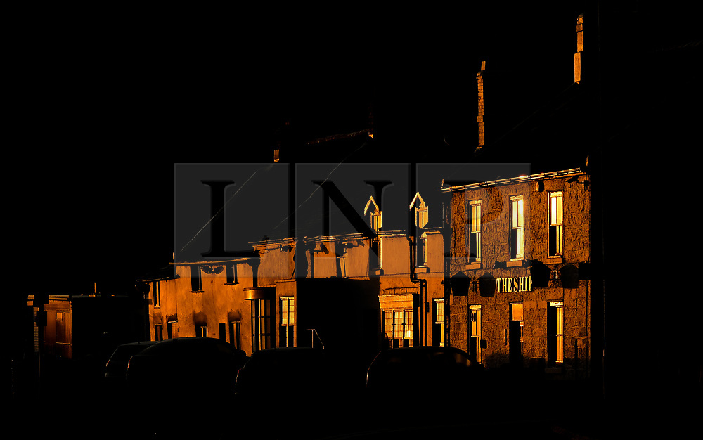 © Licensed to London News Pictures. <br /> 11/08/2017. <br /> Saltburn by the Sea, UK.  <br /> <br /> The light from the rising sun is reflected from buildings at sunrise in the North Yorkshire coastal town of Saltburn by the Sea.<br />   <br /> Photo credit: Ian Forsyth/LNP