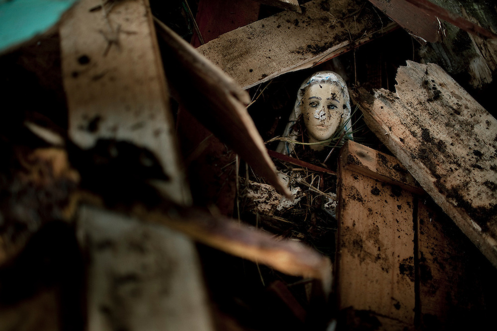 A virgin found among the debris left by a tsunami in Pelluhue, Chile. March 2, 2010.