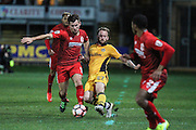 Sean Rigg of Newport County and Ryan Wilson of Alfreton Town during the The FA Cup match between Newport County and Alfreton Town at Rodney Parade, Newport, Wales on 15 November 2016. Photo by Andrew Lewis.