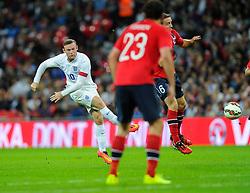 England captain, Wayne Rooney (Manchester United) Shoots - Photo mandatory by-line: Joe Meredith/JMP - Mobile: 07966 386802 - 3/09/14 - SPORT - FOOTBALL - London - Wembley Stadium - England v Norway - International Friendly