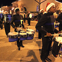 Adam Robison | BUY AT PHOTOS.DJOURNAL.COM<br /> The drumline of Tupelo High School Band plays as they march on Main Street in the Tupelo Christmas Parade Friday night in Tupelo.