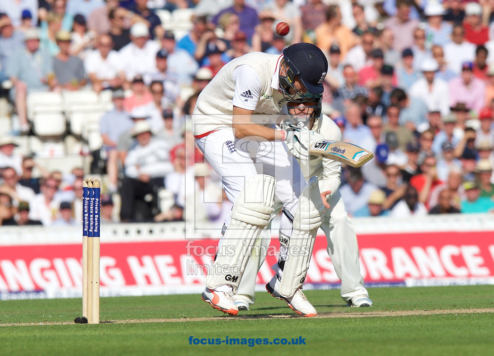 Joe Root of England ducks to avoid yet another bouncer from Mitchell Johnson of Australia while batting during the 5th Investec Ashes Test Match match at the Kia Oval, London<br /> Picture by Alan Stanford/Focus Images Ltd +44 7915 056117<br /> 21/08/2015