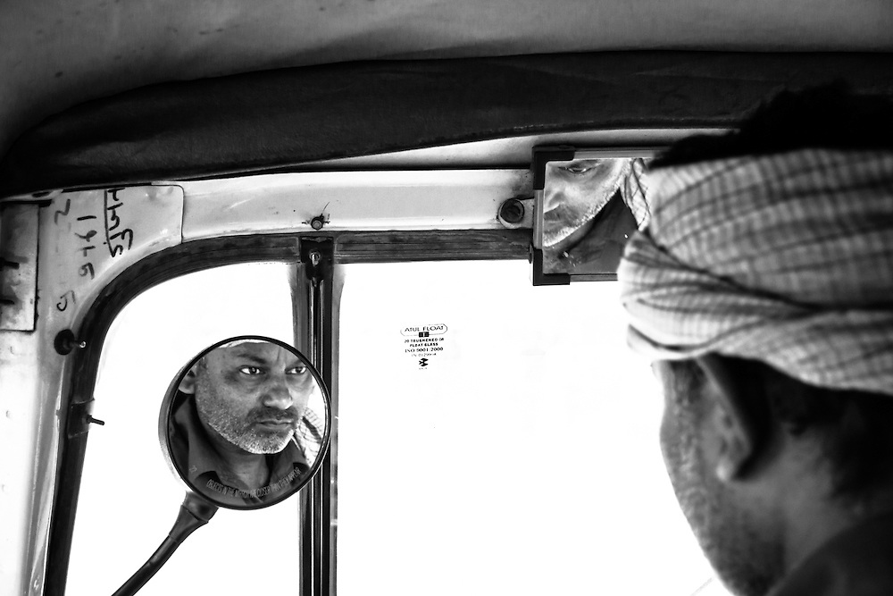 Portrait of a rickshaw driver on the streets of old Delhi, India.