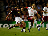 Photo: Henry Browne.<br /> Arsenal v FC Thun. UEFA Champions League.<br /> 14/09/2005.<br /> Robert Pires of Arsenal is challenged by Silvan Aegerter of Thun.