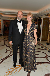 Design consultant and interior designer NAOMI CLEAVER and her husband OLIVER CLEAVER at the David Shepherd Wildlife Foundation 30th anniversary Wildlife Ball at The Dorchester, Park Lane, London on 10th October 2014.
