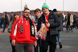 Manchester United fans before the Premier League match at Old Trafford, Manchester.