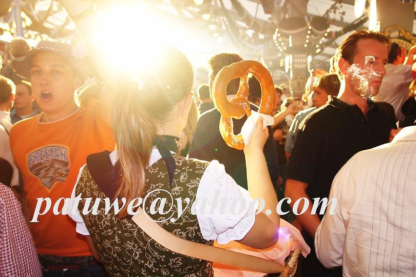 Server sell Brezen in beer tent, Oktoberfest in Theresienwiese, Munich, Bavaria, Germany