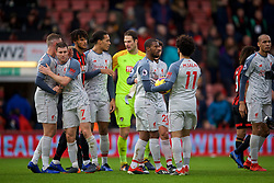BOURNEMOUTH, ENGLAND - Saturday, December 8, 2018: Liverpool's hat-trick hero Mohamed Salah, with the match ball, is congratulated by team-mate Georginio Wijnaldum after the 4-0 victory over AFC Bournemouth during the FA Premier League match between AFC Bournemouth and Liverpool FC at the Vitality Stadium. (Pic by David Rawcliffe/Propaganda)