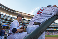 Justin Morneau #33 of the Minnesota Twins talks with teammate Brian Dozier #2 before heading onto the field during a game against the Kansas City Royals on June 27, 2013 at Target Field in Minneapolis, Minnesota.  The Twins defeated the Royals 3 to 1.  Photo by Ben Krause