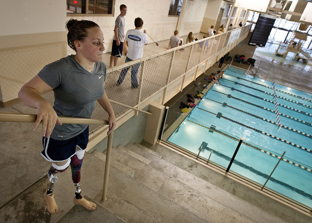 Lehi High School swimmer Amy Chapman performs step-ups during dry land practice at the Lehi Legacy Center, Tuesday, Dec. 18, 2012. Chapman, 17, was born with fibular hemimelia and had both legs amputated when she was 13 months old.