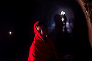 "10th December 2015, New Delhi, India. A woman in the ruins of Feroz Shah Kotla in New Delhi, India on the 10th December 2015<br /> <br /> PHOTOGRAPH BY AND COPYRIGHT OF SIMON DE TREY-WHITE a photographer in delhi<br /> + 91 98103 99809. Email: simon@simondetreywhite.com<br /> <br /> People have been coming to Firoz Shah Kotla to pray to and leave written notes and offerings for Djinns in the hopes of getting wishes granted since the late 1970's. Jinn, jann or djinn are supernatural creatures in Islamic mythology as well as pre-Islamic Arabian mythology. They are mentioned frequently in the Quran  and other Islamic texts and inhabit an unseen world called Djinnestan. In Islamic theology jinn are said to be creatures with free will, made from smokeless fire by Allah as humans were made of clay, among other things. According to the Quran, jinn have free will, and Iblīs abused this freedom in front of Allah by refusing to bow to Adam when Allah ordered angels and jinn to do so. For disobeying Allah, Iblīs was expelled from Paradise and called ""Shayṭān"" (Satan).They are usually invisible to humans, but humans do appear clearly to jinn, as they can possess them. Like humans, jinn will also be judged on the Day of Judgment and will be sent to Paradise or Hell according to their deeds. Feroz Shah Tughlaq (r. 1351–88), the Sultan of Delhi, established the fortified city of Ferozabad in 1354, as the new capital of the Delhi Sultanate, and included in it the site of the present Feroz Shah Kotla. Kotla literally means fortress or citadel."