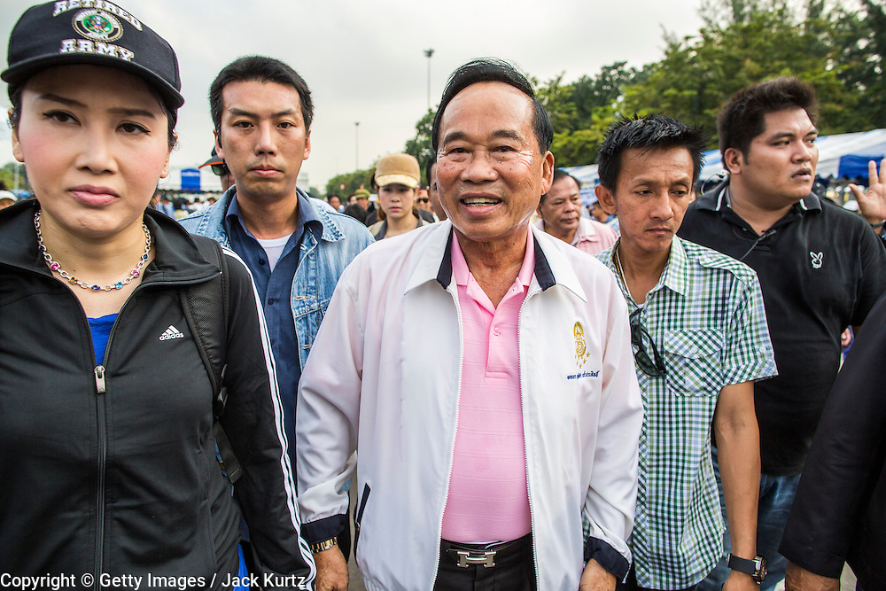 """24 NOVEMBER 2012 - BANGKOK, THAILAND: Gen Boonlert """"Seh Ai"""" Kaewprasit, leader of Pritak Siam and organizer of the anti-government rally walks through the crowd during a large anti government, pro-monarchy, protest  on November 24, 2012 in Bangkok, Thailand. The Siam Pitak group, which sponsored the protest, cited alleged government corruption and anti-monarchist elements within the ruling party as grounds for the protest. Police used tear gas and baton charges againt protesters.       PHOTO BY JACK KURTZ"""