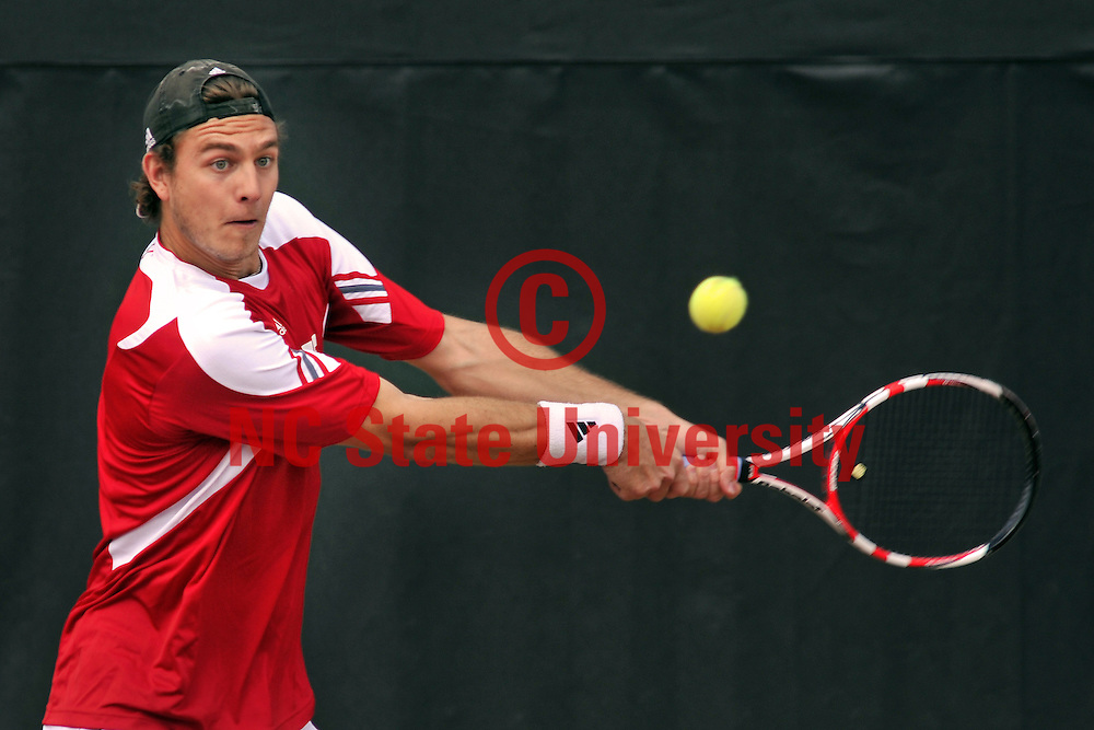 Sean Weber backhands a return of serve during doubles action against FSU.