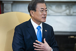 Korean President Moon Jae-in speaks to the media alongside US President Donald J. Trump (not pictured) in the Oval Office of the White House in Washington, DC, USA, 11 April 2019. President Moon is expected to ask President Trump to reduce sanctions on North Korea in an attempt to jump start nuclear negotiations between North Korea and the US.