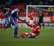 Charlton Athletic midfielder, Jordan Cousins (8) getting a hand after injury during the Sky Bet Championship match between Charlton Athletic and Cardiff City at The Valley, London, England on 13 February 2016. Photo by Matthew Redman.