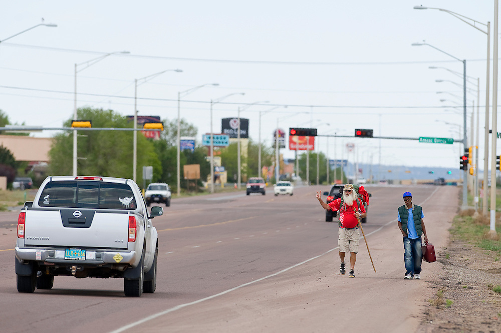 050712       Brian Leddy.Mike Oren, left, and Rodney Duraz walk down Historic Route 66 Monday morning. Oren, who is known as the Peacewalker, has walked thousands of miles in support of bringing troops home from Afghanistan. Currently he is on his way to New York City.