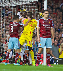 LONDON, ENGLAND - Saturday, September 20, 2014: West Ham United's Aaron Cresswell pushes Liverpool's Mario Balotelli during the Premier League match at Upton Park. (Pic by David Rawcliffe/Propaganda)