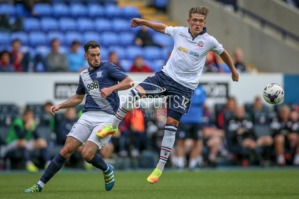 Max Clayton (Bolton Wanderers) wins a header during the Pre-Season Friendly match between Bolton Wanderers and Preston North End at the Macron Stadium, Bolton, England on 30 July 2016. Photo by Mark P Doherty.