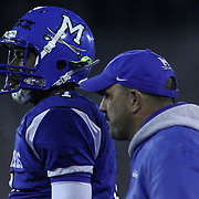 Middletown Quarterback Darius Wade (4) and Middletown head coach Mark DelPercio seen on the sidelines in the fourth quarter of the DIAA State Championship football game against Salesianum Saturday, Nov. 30 2013, at Delaware Stadium in Newark Delaware.