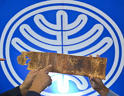 A copy of a fragment of the Dead Sea Scrolls is displayed during a press conference to launch a digitized version of the scrolls at a library in Jerusalem, Israel, December 18, 2012. Photo by Imago / i-Images...UK ONLY
