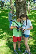 Sofia and Jamila on photo excursion at Grings Mill Park Berks Co., PA Plein aire painter Russ Slocum in background