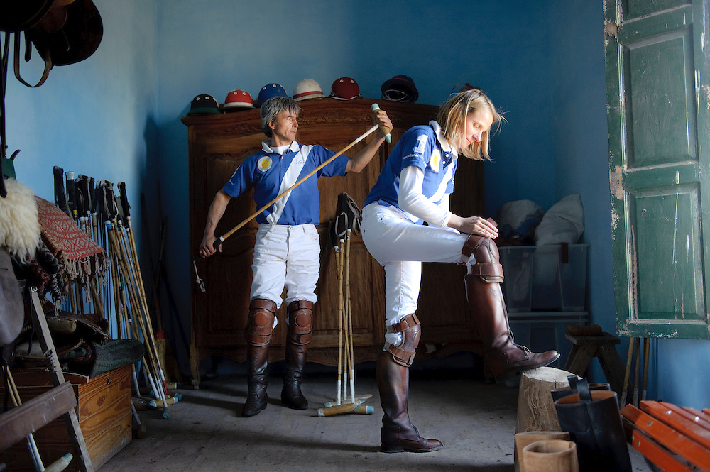 Buenos Aires Province, Argentina 20 August 2009<br /> Silke Olscher and Marcos Guiraldes, managers of Estancia La Sofia, prepare for a polo training.<br /> The Polo is a typical Argentinian team sport played on horseback in which the objective is to score goals against an opposing team.<br /> A game first played in Persia at dates given from the 6th century BC, or much earlier,to the 1st century AD and originated there.<br /> Polo was at first a training game for cavalry units, usually the king's guard or other elite troops. <br /> PHOTO: EZEQUIEL SCAGNETTI