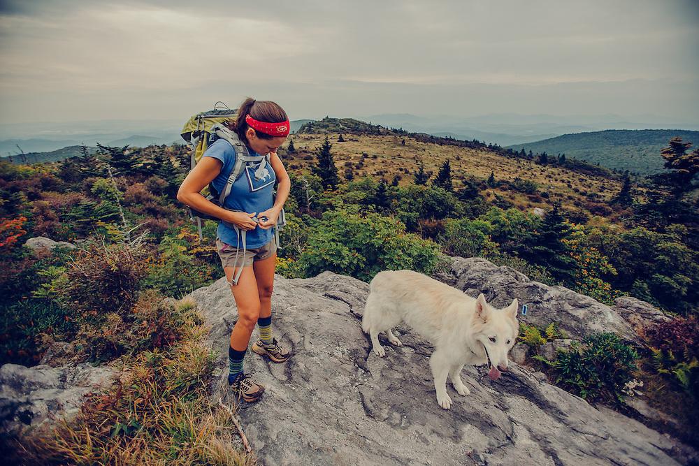 Women woman hiking, biking, backpacking, adventuring, camping, paddle boarding outdoors,