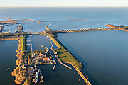 Nederland, Noord-Holland, Den Oever, 11-12-2013; begin Afsluitdijk met Stevinsluizen, schutsluis in de voorgrond. Foto richting de spuisluizen en Waddenzee <br /> Beginning Enclosure Dam with Stevin Sluices, seen to Waddenzee. Lock in the foreground.<br /> luchtfoto (toeslag op standaard tarieven);<br /> aerial photo (additional fee required);<br /> copyright foto/photo Siebe Swart.