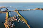 Nederland, Noord-Holland, Den Oever, 11-12-2013; begin Afsluitdijk met Stevinsluizen, schutsluis in de voorgrond. Foto richting de spuisluizen en Waddenzee <br /> Beginning Enclosure Dam with Stevin Sluices, seen to Waddenzee. Lock in the foreground.<br /> luchtfoto (toeslag op standaard tarieven);<br /> aerial photo (additional fee required);<br /> copyright foto/photo Siebe Swart.