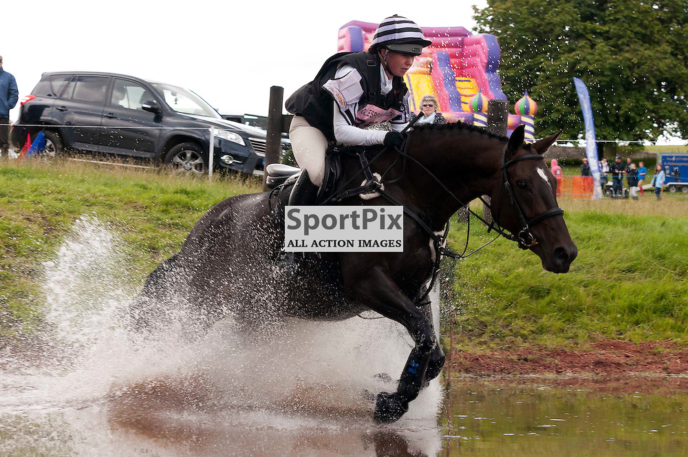(c) Colin Lunn | StockPix.eu.Emma Prangnell on Trevinnick races through the water at Gillespie Macandrew Hopetoun House Horse Trials 28 July 2012
