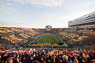 "October 15, 2011: Iowa fans hold up cards showing ""Go Hawks"" on one side and ""America Needs Farmers"" on the other right after the National Anthem and before the start of the NCAA football game between the Northwestern Wildcats and the Iowa Hawkeyes at Kinnick Stadium in Iowa City, Iowa on Saturday, October 15, 2011. Iowa defeated Northwestern 41-31."