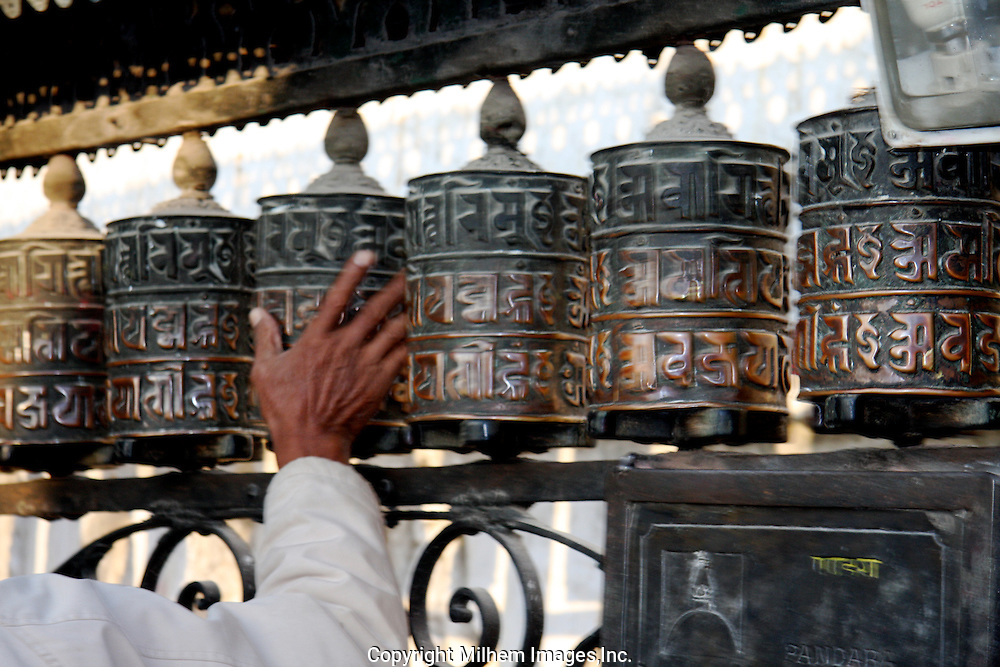 Prayer wheels are filled with Buddhist prayers and become activated with each turning of the wheel.