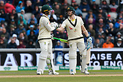 150 - Steve Smith of Australia celebrates scoring a 150 and is congratulated by Tim Paine of Australia  during the International Test Match 2019, fourth test, day two match between England and Australia at Old Trafford, Manchester, England on 5 September 2019.