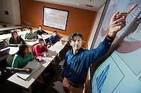 Professor Kondev instructing his class at Brandeis University in Waltham, MA.