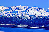 Snow covered Kenai Mountains over Kachemak Bay.  Kenai Peninsusla, Alaska.