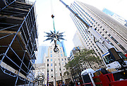 The Swarovski Star is lifted to the top of the 78-foot Rockefeller Center Christmas tree, Monday, Nov. 16, 2015, in New York. The Star, featuring 25,000 crystals and weighing 550 pounds, will sit atop the Rockefeller Center Christmas tree which will be lit on Dec. 2. (Diane Bondareff/AP Images for Swarovski)