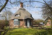Unusual round thatched cottage, Easton, Suffolk, England